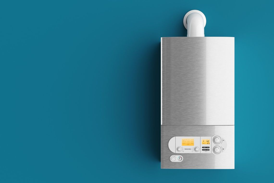 new household boiler on blue wall background